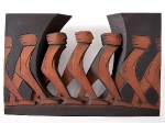 """Crossing Open Ground"" (pierced relief)   1992   Sapele with ochre and charcoal   61x93x8cm"